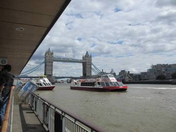 London Bridge on the Thames River with river bus