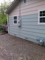 NEW FOUNDATION, NEW SIDING, NEW WINDOWS